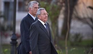 Cuban Vice President Miguel Diaz-Canel (left) is the long-presumed successor to President Raul Castro, but it is unclear how much power he will have with Mr. Castro still leading the nation's Communist Party. (Associated Press/File)