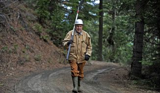 In this Wednesday, Jan. 17, 2018 photo, Jud Parsons walks through a section of his family's forestland near Mount Ashland, Ore. (Jamie Lusch/The Medford Mail Tribune via AP)