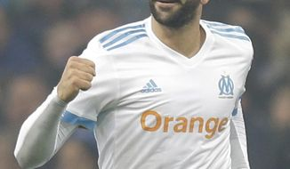 Marseille's Adil Rami, reacts after scoring during the League One soccer match between Marseille and Monaco, at the Velodrome Stadium, in Marseille, southern France, Sunday, Jan. 28, 2018. (AP Photo/Claude Paris)