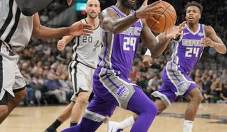 Sacramento Kings' JaKarr Sampson (29) grabs the ball ahead of San Antonio Spurs' LaMarcus Aldridge, left, during the first half of an NBA basketball game, Sunday, Jan. 28, 2018, in San Antonio. (AP Photo/Darren Abate)