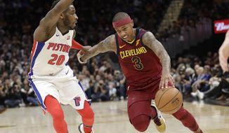 Cleveland Cavaliers' Isaiah Thomas (3) drives past Detroit Pistons' Dwight Buycks (20) in the first half of an NBA basketball game, Sunday, Jan. 28, 2018, in Cleveland. (AP Photo/Tony Dejak)