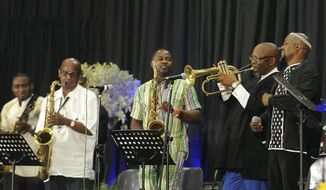 """Musicians perform at a memorial service for South African Jazz legend, Hugh Masekela, in Johannesburg, Sunday, Jan 28, 2018. The son of legendary South African jazz musician and anti-apartheid activist Hugh Masekela says his father had """"laughter and humor to the very end"""" before his death this week in Johannesburg. (AP Photo)"""