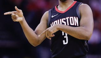 Houston Rockets guard Chris Paul gives instructions during the first half of an NBA basketball game against the Phoenix Suns, Sunday, Jan. 28, 2018, in Houston. (AP Photo/Eric Christian Smith)