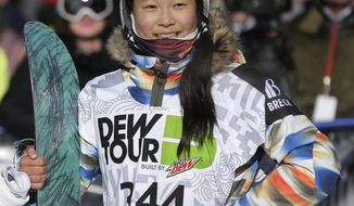 FILE - In this Dec. 14, 2013, file photo, Chloe Kim watches the replay of her second run during the snowboarding superpipe final at the Dew Tour iON Mountain Championships in Breckenridge, Colo.  Kim's  parents are from South Korea, where the Olympic games will be held starting Feb. 9, 2018.  Among the handful of relatives who live there is Chloe's grandma, who has been known to brag about her high-flying granddaughter if, say, she's out to tea with her friends and a picture of Chloe happens to appear in the newspaper, which happens fairly often. (AP Photo/Julie Jacobson, File)