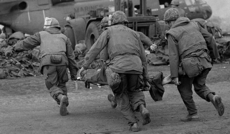 Days after these U.S. Marines at Khe Sanh carried a wounded comrade to be evacuated, North Vietnamese troops blocked a rescue platoon. (Associated Press/File)
