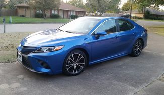The 2018 Toyota Camry Hybrid safety features include a variety of air bags driver, passenger, front head, rear head, front side and rear side air bags, 4-wheel ABS, 4-wheel disc brakes, brake assist, electronic stability control, daytime running lights, child safety locks, traction control, blind spot monitoring, lane departure warning, lane keeping assist and cross-traffic alert.  You also get a rearview camera, adaptive cruise control, and the Toyota Safety Sense suite with a  forward collision warning and pedestrian detection. (Photo by Rita Cook).
