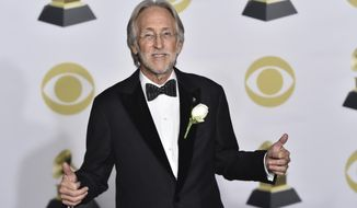 President of The Recording Academy Neil Portnow poses in the press room at the 60th annual Grammy Awards at Madison Square Garden on Sunday, Jan. 28, 2018, in New York. (Photo by Charles Sykes/Invision/AP)