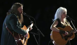 """Chris Stapleton and Emmylou Harris perform """"Wildflowers"""" during an In Memoriam tribute to Tom Petty at the 60th annual Grammy Awards at Madison Square Garden on Sunday, Jan. 28, 2018, in New York. (Photo by Matt Sayles/Invision/AP)"""