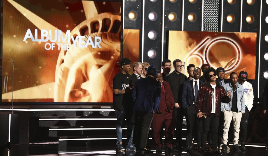 """Bruno Mars, front center, accepts the award for album of the year for """"24K Magic"""" at the 60th annual Grammy Awards at Madison Square Garden on Sunday, Jan. 28, 2018, in New York. (Photo by Matt Sayles/Invision/AP)"""
