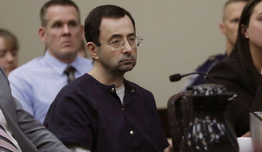 FILE - In this Jan. 24, 2018, file photo, Larry Nassar sits during his sentencing hearing in Lansing, Mich. The House has followed up on the sex abuse scandal involving Nassar with the passage of legislation that requires governing bodies for amateur athletics to promptly report claims of abuse to law enforcement. (AP Photo/Carlos Osorio, File)