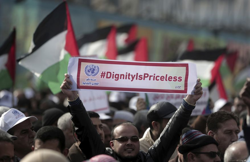 Thousands of employees of the U.N agency for Palestinian refugees demonstrate in support of their organization following U.S. funding cuts in Gaza City, Monday, Jan. 29, 2018. Earlier this month, the Trump administration slashed $60 million of a planned $125 million funding installment for 2018. Washington wants the Palestinian Authority to return to the negotiating table with Israel in exchange for aid resumption. (AP Photo/ Khalil Hamra)