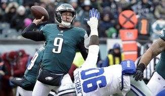 FILE - In this Dec. 31, 2017, file photo, Philadelphia Eagles' Nick Foles (9) throws a pass over Dallas Cowboys' DeMarcus Lawrence (90) during the first half of an NFL football game in Philadelphia. Foles will be the 14th quarterback to start in a Super Bowl after not starting the regular season opener for his team. (AP Photo/Chris Szagola, File) **FILE**