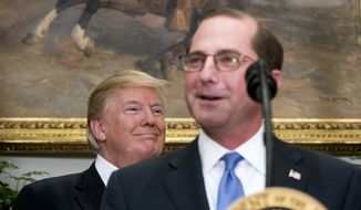 President Donald Trump, left, listens as Health and Human Services Secretary Alex Azar, right, speaks after being sworn in at the Roosevelt Room at the White House, Monday, Jan. 29, 2018, in Washington. (AP Photo/Andrew Harnik)