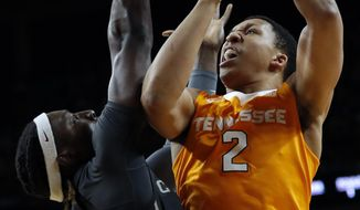 Tennessee forward Grant Williams (2) shoots over Iowa State forward Solomon Young, left, during the first half of an NCAA college basketball game, Saturday, Jan. 27, 2018, in Ames, Iowa. (AP Photo/Charlie Neibergall)