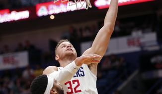 Los Angeles Clippers forward Blake Griffin (32) goes to the basket over New Orleans Pelicans forward Anthony Davis (23) in the first half of an NBA basketball game in New Orleans, Sunday, Jan. 28, 2018. (AP Photo/Gerald Herbert)