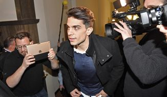Dortmund's Marc Bartra of Spain arrives at the courtroom in Dortmund, Germany, to testify as witness at the trial against a man, charged with the attempted murder of Borussia Dortmund's soccer team by detonating homemade bombs on their bus, Monday, Jan. 29, 2018. Bartra was injured from the detonation. (AP Photo/Martin Meissner)
