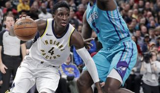 Indiana Pacers guard Victor Oladipo (4) drives past Charlotte Hornets guard Jeremy Lamb (3) during the second half of an NBA basketball game in Indianapolis, Monday, Jan. 29, 2018. (AP Photo/Michael Conroy)