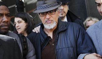 File-This March 9, 2017, file photo shows Ravi Ragbir, executive director of the New Sanctuary Coalition, being escorted by supporters after his annual check-in with Immigration and Customs Enforcement, in New York. U.S. Rep. Nydia Velazquez has invited the wife of detained immigrant rights activist Ravi Ragbir to President Donald Trump's State of the Union address. Ragbir was in federal custody Saturday, several weeks after he was arrested during a routine check-in with the Immigration and Customs Enforcement agency. On Saturday, Velazquez, a Democrat, joined Ragbir's wife, Amy Gottlieb, and other elected officials at a rally in front of the Manhattan office building that houses ICE.  (AP Photo/Seth Wenig, File)