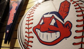 A Chief Wahoo logo is shown on a baseball at the Cleveland Indians team shop, Monday, Jan. 29, 2018, in Cleveland. Divisive and hotly debated, the Chief Wahoo logo is being removed from the Cleveland Indians' uniform next year. The polarizing mascot is coming off the team's jersey sleeves and caps starting in the 2019 season. The Club will still sell merchandise featuring the mascot in Northeast Ohio. (AP Photo/Tony Dejak)