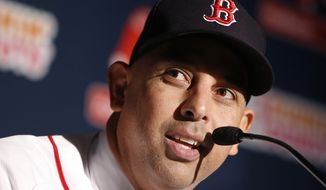 In this Nov. 6, 2017 photo, Boston Red Sox manager Alex Cora speaks after being introduced as the 47th manager and first Latino manager in the club's history in Boston. Cora is the youngest Red Sox manager in decades, and the team hopes his ability to relate to his players will help the team on the field. (AP Photo/Michael Dwyer)