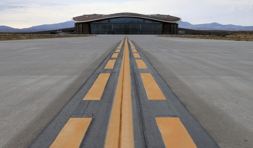 FILE - This Dec. 9, 2014, file photo shows the taxiway leading to the hangar at Spaceport America in Upham, N.M. Operators of the New Mexico Spaceport Authority that runs Spaceport America in southern New Mexico are seeking greater confidentiality for tenants that include aspiring commercial spaceflight company Virgin Galactic. (AP Photo/Susan Montoya Bryan, file)