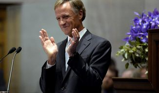 Tennessee Gov. Bill Haslam applauds after introducing his wife Crissy before giving his annual State of the State address to a joint convention of the Tennessee General Assembly Monday, Jan. 29, 2018, in Nashville, Tenn. (AP Photo/Mark Zaleski)