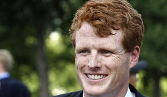 FILE - In this July 26, 2017, file photo, Rep. Joe Kennedy, D-Mass., smiles on Capitol Hill in Washington. Kennedy, grandson of Robert F. Kennedy, will give the Democratic response to President Donald Trump's State of the Union speech. (AP Photo/Jacquelyn Martin, File)