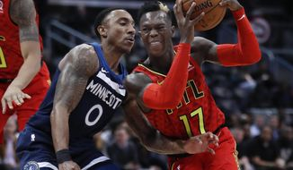 Atlanta Hawks guard Dennis Schroder (17) drives against Minnesota Timberwolves guard Jeff Teague (0) in the first half of an NBA basketball game Monday, Jan. 29, 2018, in Atlanta. (AP Photo/John Bazemore)