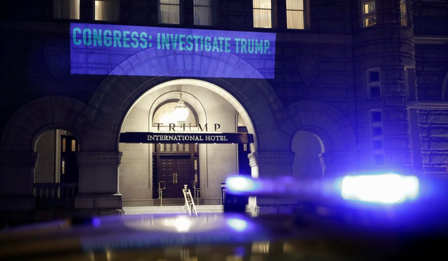 UltraViolet, a national women's group, projects a message on the side of the Trump International Hotel before Tuesday's State of the Union address. (Associated Press photographs)