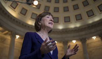 Sen. Susan Collins, R-Maine, who moderated bipartisan negotiations in her office to break the government shutdown stalemate, describes the power of the centrists and her efforts to keep the talks civil, during a TV news interview on Capitol Hill in Washington, Tuesday, Jan. 23, 2018. (AP Photo/J. Scott Applewhite)