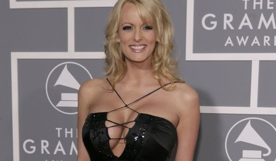 FILE - In this Feb. 11, 2007 file photo, Stormy Daniels arrives for the 49th Annual Grammy Awards in Los Angeles.  ABC's Jimmy Kimmel is bringing Daniels on his show next Tuesday, Jan. 30, 2018,  on the night of President Donald Trump's State of the Union speech. Daniels is in the news following reports that she had an affair with the future president in 2006. The Wall Street Journal reported that Trump's lawyer arranged a payment to Daniels to prevent her from talking about the alleged encounter before the 2016 presidential election. (AP Photo/Matt Sayles)