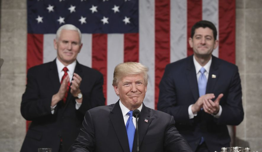 President Donald Trump pauses as delivers his first State of the Union address in the House chamber of the U.S. Capitol to a joint session of Congress Tuesday, Jan. 30, 2018 in Washington, as Vice President Mike Pence and House Speaker Paul Ryan applaud. (Win McNamee/Pool via AP)