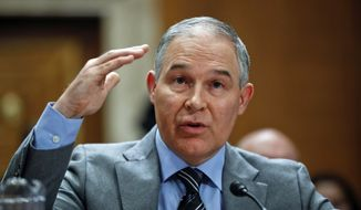 Environmental Protection Agency Administrator Scott Pruitt testifies before the Senate Environment Committee on Capitol Hill in Washington, Tuesday, Jan. 30, 2018. (AP Photo/Pablo Martinez Monsivais)