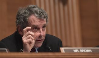 Senate Banking Committee ranking member Sen. Sherrod Brown, D-Ohio, asks a question of Treasury Secretary Steven Mnuchin as he testifies before the Senate Banking Committee on Capitol Hill in Washington, Tuesday, Jan. 30, 2018, on the Financial Stability Oversight Council. (AP Photo/Susan Walsh)