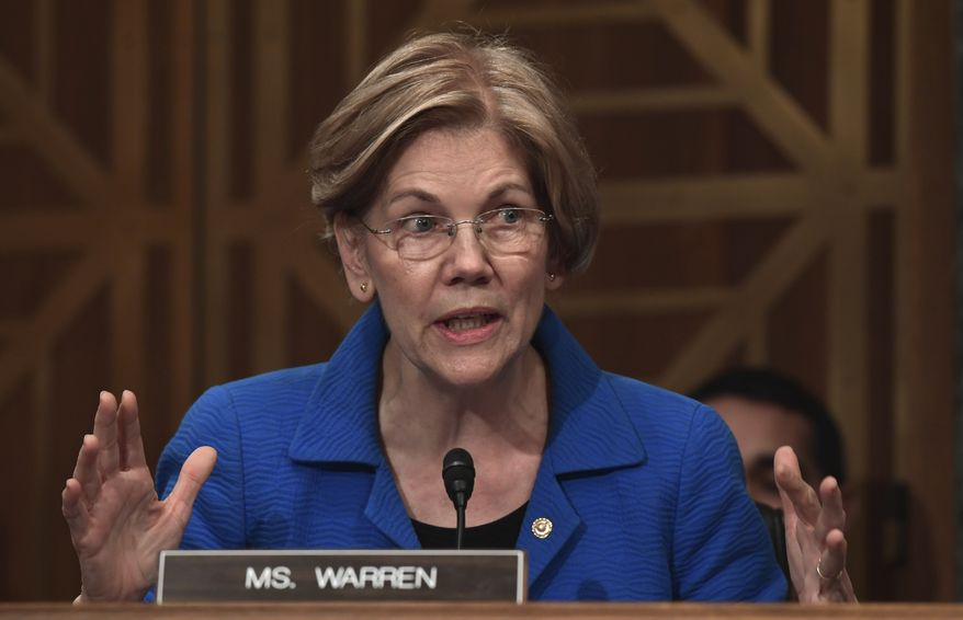 Sen. Elizabeth Warren, D-Mass., asks a question of Treasury Secretary Steven Mnuchin during a Senate Banking Committee hearing on Capitol Hill in Washington, Tuesday, Jan. 30, 2018, on the Financial Stability Oversight Council. (AP Photo/Susan Walsh) ** FILE **