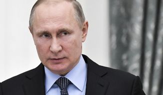 """In this photo taken on Monday Jan. 29, 2018, Russian President Vladimir Putin attends the ceremony of signing a 2018-2020 general agreement between Russian trade unions, employers and the Russian Government in Moscow, Russia. The Trump administration late Monday, released released a long-awaited list of 114 Russian politicians and 96 """"oligarchs"""" who have flourished under President Vladimir Putin, fulfilling a demand by Congress that the U.S. punish Moscow for interfering in the 2016 U.S. election. (Alexei Nikolsky, Sputnik, Kremlin Pool Photo via AP)"""