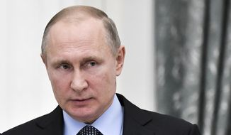 Russian President Vladimir Putin and Christopher Steele, author of a debunked anti-Trump dossier, had close associations among the cadre of business-ruling oligarchs, government reports show. (Associated Press/File)