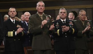 Chief of Naval Operations Adm. John Richardson, from left, Chairman of the Joint Chiefs of Staff Gen. Joseph Dunford, Chief of Staff of the Army Gen. Mark Milley, and Commandant of the Marine Corps Gen. Robert Neller listen as President Donald Trump delivers his first State of the Union address in the House chamber of the U.S. Capitol to a joint session of Congress Tuesday, Jan. 30, 2018 in Washington. (Win McNamee/Pool via AP)