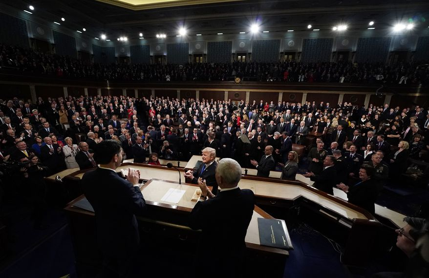 President Donald Trump arrives to deliver his State of the Union address to a joint session of U.S. Congress on Capitol Hill in Washington, Tuesday, Jan. 30, 2018. (Jim Bourg/Pool via AP)