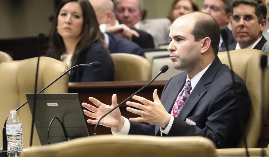 Matthew Miller, assistant director of the legal division at the Bureau of Legislative Research, speaks to legislators Tuesday, Jan. 30, 2018, in Little Rock, Ark., about a recent state Supreme Court decision restricting lawsuits against the state. Some are concerned the ruling could increase demands on the state Claims Commission, which considers financial claims against Arkansas. (AP Photo/Kelly P. Kissel)