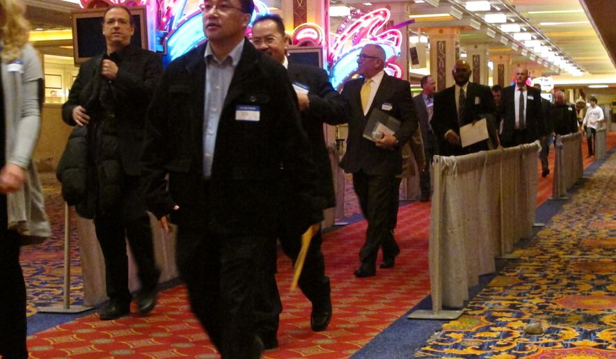 Applicants for jobs at the soon-to-open Hard Rock casino in Atlantic City N.J. line up for interviews on Tuesday, Jan. 30, 2018, at a hotel nearby. Tuesday's event was for former workers at the Trump Taj Mahal, which closed in 2016 but will reopen this summer as a Hard Rock casino resort. The former Revel casino is reopening around the same time as well as the Ocean Resort casino, adding thousands of jobs to a market that lost 11,000 since 2014 due to casino closings. (AP Photo/Wayne Parry)