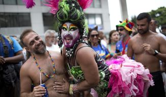 "In this Saturday, Jan. 27, 2018 photo, revelers in costume participate in the Banda de Ipanema carnival ""bloco"" parade in Rio de Janeiro, Brazil. Rio's health authorities are urging Carnival visitors to stick to celebrations in the city and avoid sightseeing at waterfalls and forests where yellow fever has been detected. (AP Photo/Silvia Izquierdo)"