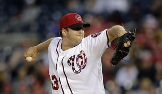 FILE - In this Oct. 1, 2017, file photo, Washington Nationals relief pitcher Matt Albers pitches during a baseball game against the Pittsburgh Pirates in Washington. Albers has finalized a $5 million, two-year contract with the Milwaukee Brewers on Tuesday, Jan. 30, 2018. The 35-year old is coming off a standout season in Washington, where he was a career-best 7-2 with a 1.62 ERA in 63 games. (AP Photo/Mark Tenally, File) **FILE**