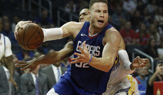 FILE- In this Jan. 6, 2018, file photo, Los Angeles Clippers forward Blake Griffin, right, drives to the basket against Golden State Warriors guard Patrick McCaw during the first half of an NBA basketball game in Los Angeles. The Detroit Pistons dramatically shook their struggling roster by acquiring one of the NBA's top players in Griffin in a trade with the Clippers. The deal for the five-time All-Star forward was announced early Tuesday, Jan. 30, 2018, giving Detroit a player who has been the face of the Clippers but whose career has been undercut by injuries. (AP Photo/Alex Gallardo, File)