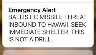 This Jan. 13, 2018, file smartphone screen capture shows a false incoming ballistic missile emergency alert sent from the Hawaii Emergency Management Agency system. The Federal Communications Commission says human error and inadequate safeguards are to blame for a missile alert that was sent mistakenly in Hawaii. The FCC said Tuesday, Jan. 30, that the individual who sent the false alert refused to talk to the agency, but provided a written statement. The FCC says Hawaii has been testing alert capabilities, and he mistook a drill for a real warning about a missile threat. He responded by sending the alert. There was no sign-off from a supervisor. (AP Photo/Caleb Jones, file)