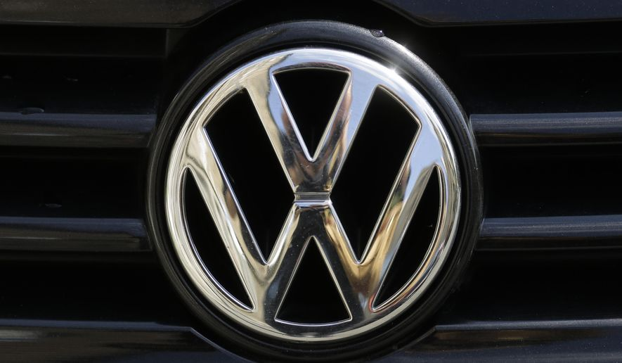 """FILE - In this Aug. 1, 2017 file photohe brand logo of German car maker Volkswagen, VW, is photographed on a car in Berlin, Germany. The chairman of Volkswagen says that diesel exhaust tests involving monkeys were """"totally incomprehensible"""" and the matter must be """"investigated fully and unconditionally."""" Monday's comments by Hans Dieter Poetsch, reported by the dpa news agency, come in the wake of a report by the New York Times that a research group funded by auto companies exposed monkeys to diesel exhaust from a late-model Volkswagen, while another group was exposed to fumes from an older Ford pickup. (AP Photo/Markus Schreiber, file)"""
