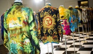 Creations of Italian designer Gianni Versace are displayed at an exhibition to honor him more than 20 years after his death in 1997, at the Kronprinzenpalais in Berlin, Germany, Tuesday, Jan. 30, 2018. (AP Photo/Markus Schreiber)
