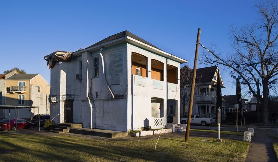 This Jan. 9, 2018 photo provided by The National Trust for Historic Preservation shows the LULAC Council 60 Clubhouse in Houston that remains damaged a month after Hurricane Harvey inflicted more harm to the aging building. The clubhouse connected to the Mexican-American Civil Rights movement has been designated as a National Treasure and will share part of a $450,000 grant in an effort to raise money for restore historic buildings damaged by last year's hurricanes, the National Trust for Historic Preservation announced Tuesday, Jan. 30, 2018. (Dee Zunker/National Trust for Historic Preservation via AP)