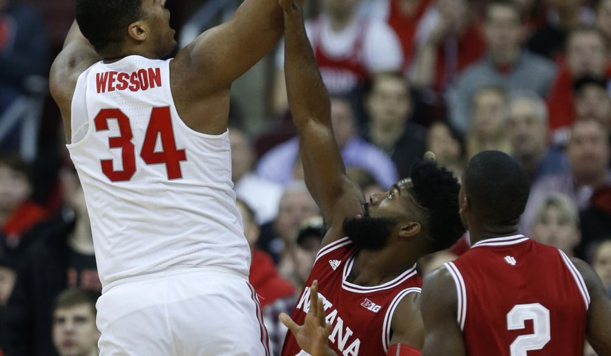 Ohio State forward Kaleb Wesson, left, goes up for a shot ...