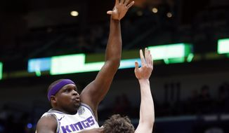 Sacramento Kings forward Zach Randolph shoots over New Orleans Pelicans center Omer Asik (3) in the first half of an NBA basketball game in New Orleans, Tuesday, Jan. 30, 2018. (AP Photo/Gerald Herbert)
